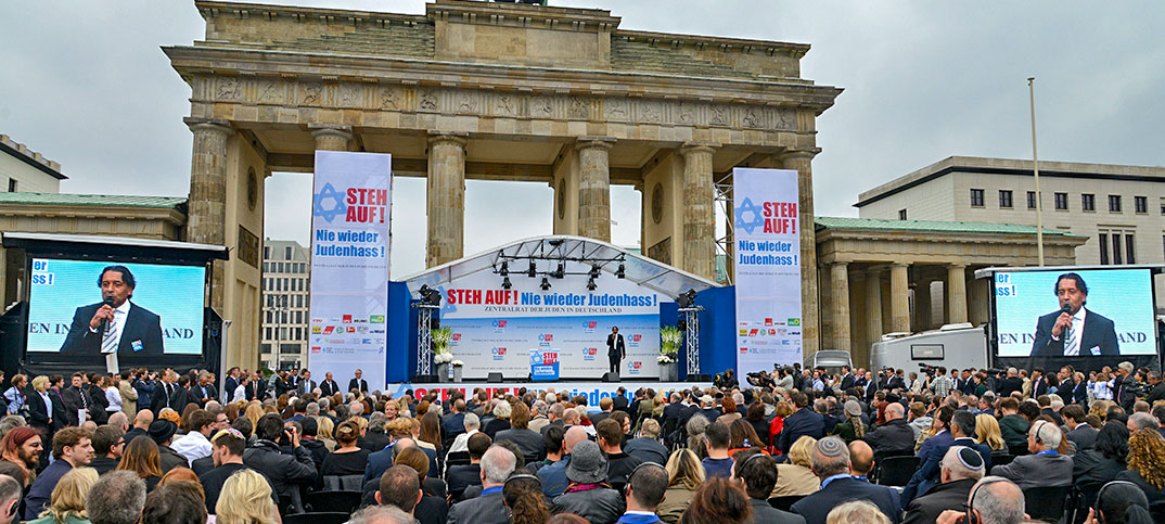 Cherno Jobatey hosts anti-semitism rallye at Brandenburg Gate Berlin